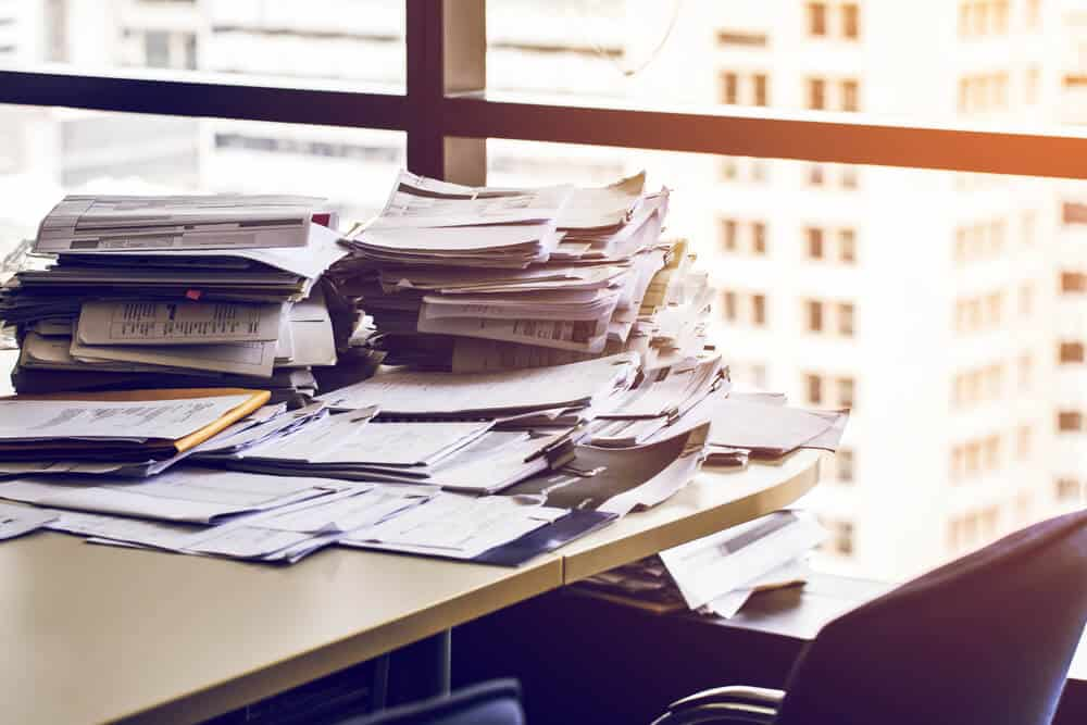 Piles on Paper on Desk
